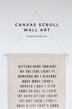 Hang a canvas scroll with your favorite quotes or song lyrics for instant wall art!