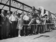 Jesse Owens practices aboard the SS Manhattan on the way to the Olympic games in Berlin, 1936 -