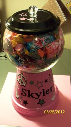 What a treat-this was so much fun making for my Granddaughter's Bday-Gumball Machine-made from a (painted) clay pot w/bottom, fish bowl, knob and vinyl cut-outs from my Cricut and embellishments.  Filled with misc. candy!  FUN!!