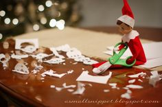Elf on the Shelf making snowflakes