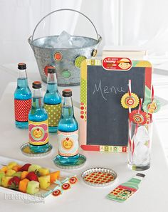 Hold a vintage soda shop party with paper crafted invitations, bottle wraps, and more; Betsy Veldman for Paper Crafts Party Ensembles