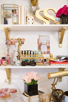 SS Print Shop's Stephanie Sterjovski at Home | The Everygirl // gold, white, pink bedroom // shelf styling // photo by Anna With Love