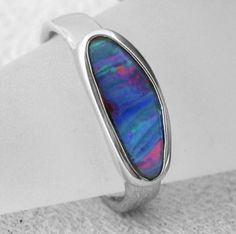 Cross finger free form design with plain sterling silver bezel using boulder opal. A feature for ladies fashions and jewelry (jewellery)