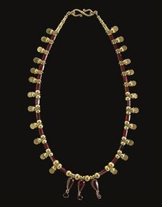 A GREEK GOLD AND GARNET BEAD NECKLACE     HELLENISTIC PERIOD, CIRCA 2ND-1ST CENTURY B.C.