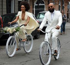 Solange and Alan Ferguson-arrive on bikes to their-wedding