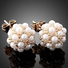pearl cluster studs.