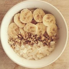Coconut Smoothie Bowl shared by lex_toneitup! 4 tbsp coconut flour, 1/2 scoop of vanilla Perfect Fit Protein, and 1 cup almond milk. Top with sliced bananas, granola, cinnamon and shredded coconut.