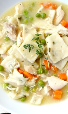 Chicken and Southern Herb Dumplings...homemade and beyond delicious! Yummy chicken, thick wonderful dumplings and just the right amount of veggies in a wonderful chicken broth.
