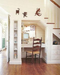 Built-in desk & bookshelf -  I might have to give up my coat closet under the stairs for this!!  THOUGHT _ make it faux and make it swing out of closet space. Home office in the kitchen if it were faux.