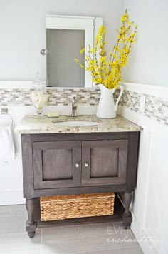 DIY Powder Room Makeover | Everyday Enchanting - A small, dark powder room gets an update with board & batten, Benjamin Moore Wickham Gray paint, a tile border, a DIY vanity, and a beadboard ceiling.