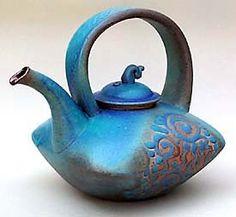 clay, teapots, peek potteri, hands, blue teapot