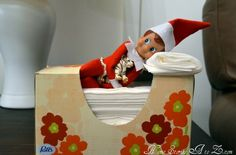 Elf on A Shelf napping in the kleenex box/bed.