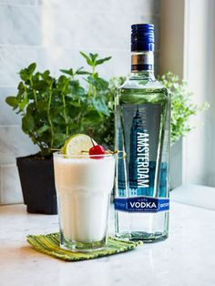 Stars & Stripes Cocktail Recipes - 2 oz vodka, 1 oz pineapple juice, 1 scoop vanilla ice cream, blend in blender, garnish with a lime wedge
