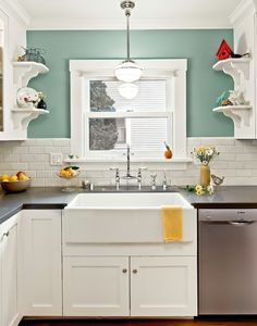 Kitchen Paint color: Benjamin Moore Kensington Green #710 kitchen remodel subway tile and black countertops...I really like this style of kitchen minus the shelves. Maybe with a paint color that is a little less bright