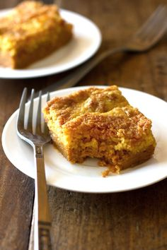 Pumpkin Bars (15 oz can pumpkin; 12 oz can evaporated milk; 1 c white sugar; 1/2 c brown sugar; 4 beaten eggs; 1 tsp cinnamon; 1/4 tsp salt; 1/4 tsp ginger; 1/2 tsp cloves; 1 15 oz yellow cake mix with pudding; 2 sticks butter, melted.)