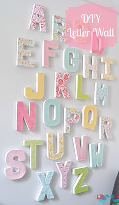 12 Home Decor Modge Podge Projects- Lots of tutorials, including this DIY letter wall by 'The Love Nerds'! modge podge letters, diy alphabet letters, playroom, baby craft, letter wall