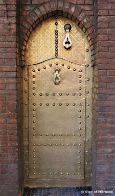 Brass Moroccan Door  #Morocco is the setting of Garment of Shadows, a Mary Russell and #SherlockHolmes #mystery #novel by Laurie R. King.