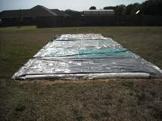 Make your own slip n slide with a tarp or two and baby shampoo. We did this for a birthday party and it was a hit! (buy stuff for)