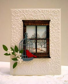 handmade window card ... white embossing folder texture ... black die cut window frame ... trees from Lovely as a Tree outside ... adorable branch with flowers ... die cut cage with red bird ... awesome!!