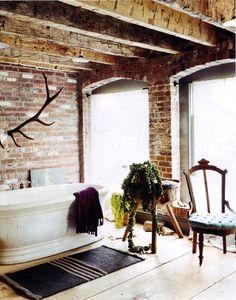 rustic bathroom, wood, brick and antlers