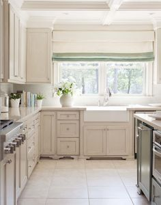 Suzie: Tobi Fairley - Fantastic kitchen design with ivory off-white shaker kitchen cabinets, ...