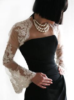 I love the ivory bolero and pearls with the black dress. The dress is a perfect fit too! That's how strapless is supposed to look!