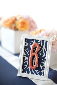 use scrapbook paper behind table numbers to add pop of color