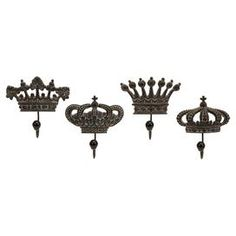 """Set of four metal and porcelain wall hooks with regal crown designs. Oh so adorable for the Queens Store       Product: 4 Piece wall hook set     Construction Material: Metal and porcelain   Color: Antiqued metal  Features: Each hook is slightly different, but complementary to the set   Dimensions: 6.25"""" H x 6.25"""" W x 2.75"""" D each"""