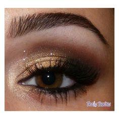 Gold Smokey Eye. Perfect for Homecoming :)