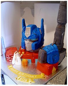This Optimus Prime cake designed by Cakerific does double-duty, it transforms between a birthday cake and a groom's cake.   It was actually a surprise from the bride-to-be who knew it was one of her future husband's favorite cartoons.   Definitely one of those incredible marriages made in geek heaven.