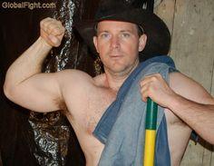 cowboy flexing arm horse farm barn