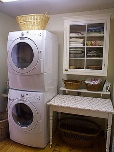 stack w/d in small laundry room for more cabinet/counter space?