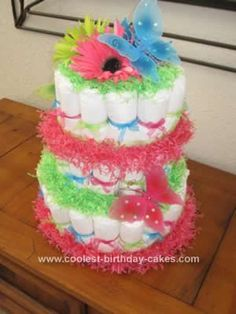 Homemade Butterfly Diaper Cake Design... This website is the Pinterest of diaper cake ideas