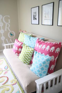Great assortment of colors and patterns in these #pillows.  #playroom #chevron #elephant
