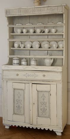 Cabinet with Pictures, Dining Room. White, Grey, Chippy, Shabby Chic, Whitewashed, Cottage, French Country, Rustic, Swedish decor Idea. *** Repinned from Angela Millan Garcia ***.