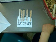 spelling practice - clothespins and sentence strips.