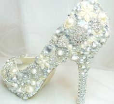 White bejeweled pumps