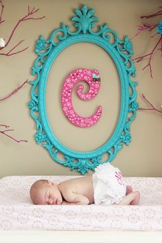 Adorable spray painted frame with scrapbook covered letter - would work for older girls too! I want to do this for my new niece!