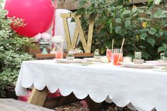 DIY scalloped tablecloth from a drop cloth.