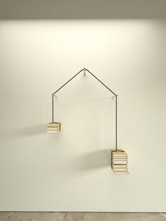 Constructed of leather straps hung across supports, Read-unread physically weighs the balance of books that have been read, against those yet to be read.