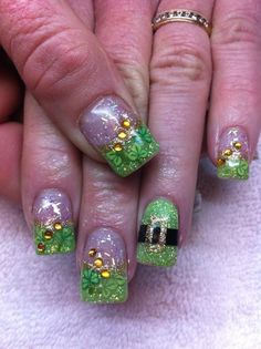 St. Patrick's Day nail design with gold and leprechaun hat!