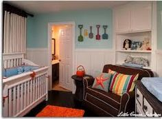 Beach baby room. Love the shovels on the wall.