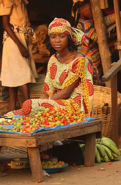 Young woman in colorful dress selling hot peppers (Kpalimé, Plateaux Region, Togo)