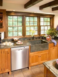#Kitchen Idea of the Day: Shaker Kitchens. (By Crown Point Cabinetry). Love the soapstone sink and ceiling beams!