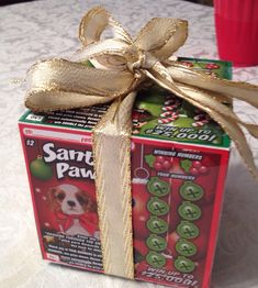 Lottery tickets made into a box. I am going to try this next year to give as a gift !