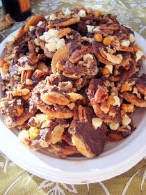 Ritz Cracker Candy: 1 to 2 sleeves of Ritz crackers, 1 1/2 cup unsalted butter, 1 1/2 cup firmly packed brown sugar, 1/2 cup chocolate chips, 1/2 cup chopped pecans, 1/2 cup peanut butter chips/white chocolate chips.