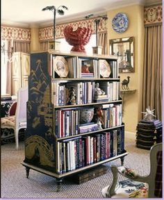 In Alex Papachristidis' living room, a freestanding chinoiserie bookcase holds quite a few books and doubles as a room divider and a large accessory!