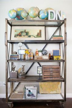 Goring to do this to my Home Depot shelves with spray paint, reclaimed wood for the shelves and huge casters!