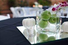 Simple fruit centerpiece accented with white-painted pumpkins and candles