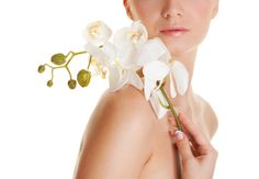 Beautiful woman with orchid flower by judithrosek, via Flickr